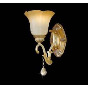 Luxury Classic Wall Sconce Features Delicate Brass Finish Oval Base and Graceful Scrolling Arm