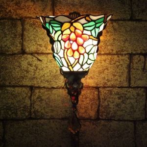Crystal Accented Country Style 8 Inch Wide Tiffany Wall Sconce with Grape Fruit Pattern